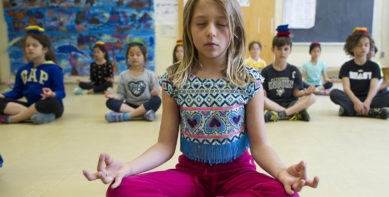 """MACLEANS-MEDITATION-05.23.14-TORONTO, ON: Grade 3 students at the Dewson Street Junior Public School attend a meditation class called """"Area 33."""" The class is run by Phys-Ed teacher Mary-Ann Kowal in an effort to promote relaxation and self reflection in a world where children are often over-managed and being told what to do on a constant basis. Photograph by Cole Garside"""